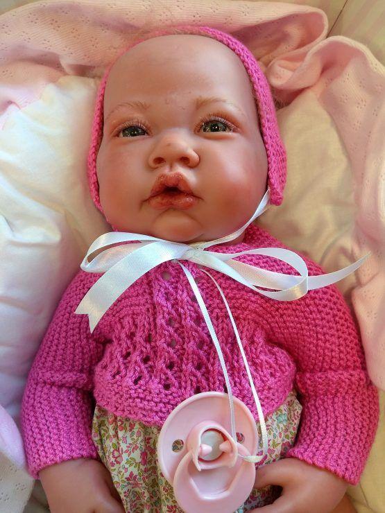 Muñeco Reborn 42 cm Cuerpo de trapo traje rosa